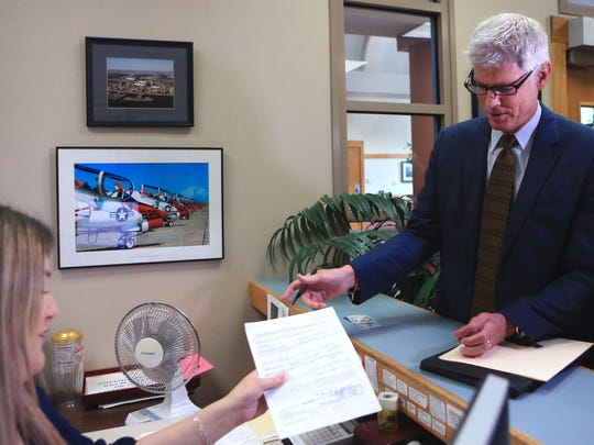 Former city councilman Mark Scott filed his paperwork with the city secretary on Monday to run for mayor in the special election.