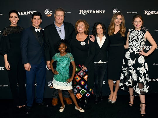 "In this March 23, 2018, file photo (from left), Whitney Cummings, Michael Fishman, John Goodman, Jayden Rey, Roseanne Barr, Sara Gilbert, Sarah Chalke and Emma Kenney arrive at the Los Angeles premiere of ""Roseanne"" in Burbank, California."