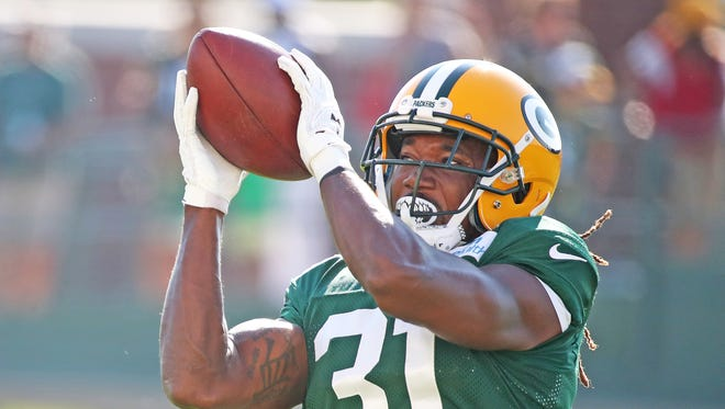 Green Bay Packers cornerback Davon House catches a ball during training camp practice Monday, July 31, 2017, at Ray Nitschke Field in Ashwaubenon, Wis.