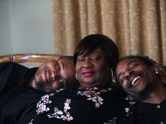 May 11, 2018 - Yolanda Tate is flanked by her former foster children, Devonta Tate (left), 24, and Marquez Hardaway, 25, during a portrait shoot in their home on Friday. Tate has spent much of her life as a foster mother to teenage boys.