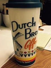 A Dutch Bros. Coffee mug