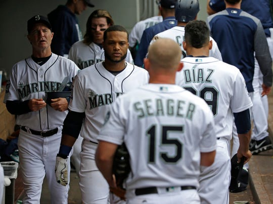 Seattle Mariners players and coaches walk through the dugout after losing 5-4 to the Philadelphia Phillies on Wednesday.