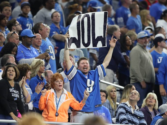 Lions fans celebrate in the fourth quarter of the Lions' 35-23 win over the Cardinals in the season opener Sunday, Sept. 10, 2017 at Ford Field.