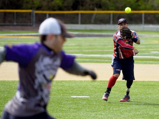 Saul Bosquez of Manchester, N.H., throws the ball to first base in a play against Dallastown's American Legion Post 605 on Saturday at Horn Field in Red Lion. The Wounded Warrior Amputee Softball Team played a doubleheader in Red Lion, with the first game against Dallastown's American Legion Post 605 and the second against a squad from Apple Automotive Group.