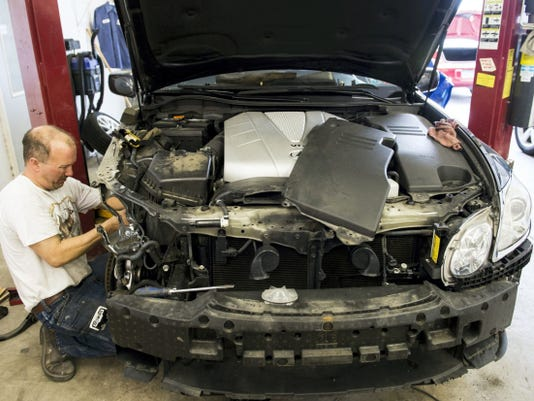 Bryan Garrett, an auto body technician at Yancey's Auto Body in Ebenezer, works on a Lexus GS 350 this week. Yancey's place first in the best paint/autobody shop category of the Best of the Lebanon Valley contest. See a photo gallery of Yancey's technicians at work at photos.ldnews.com.