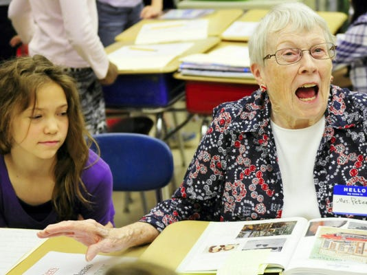 Beverly Peters, right, chats with Becca Shearer and other students during her visit Friday to Chambersburg Area Middle School South during Senior Citizen Day. Peters is also a former school teacher.