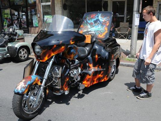 Hank Greenawalt of Lebanon looks over the 2004 Boss Hoss owned by Keith Jones of Mechanicsburg,Pa. at the 1st Lebanon Motorcycle Show. Lebanon Daily News/ Earl Brightbill