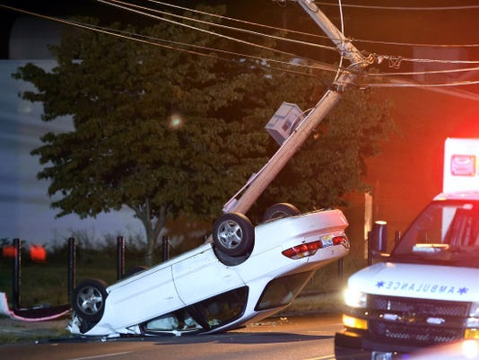 Lebanon crash: A car rests on its roof after it crashed into a utility police at 9:35 p.m. Thursday at 1450 Cumberland St. The crash shut down Cumberland Street while crews cleared the roadway. A police report was not available.