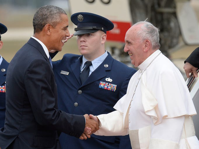 U.S. President Barack Obama greets Pope Francis on