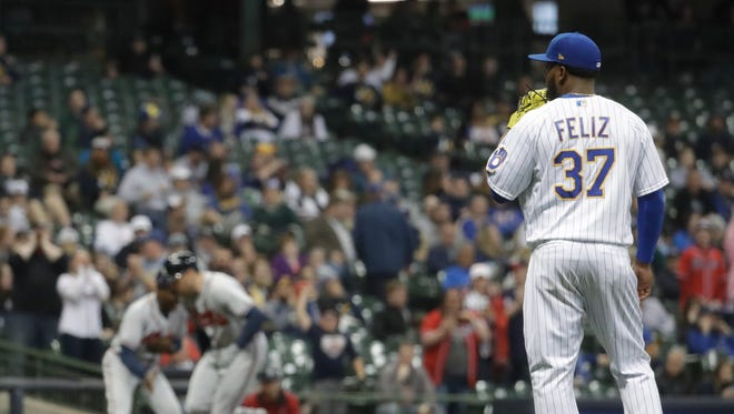 Milwaukee Brewers relief pitcher Neftali Feliz watches Freddie Freeman round the bases adter his two-run home run in the ninth inning.