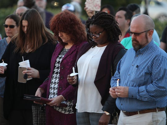 A crowd bows their head in prayer in front of the Tom Green County Courthouse on Tuesday during a prayer rally for religious freedom.