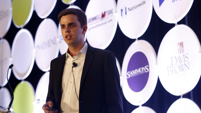 Justin Coaldrake of ClinicNote makes his presentation Wednesday during the Global Insurance Accelerator Demo Presentations at the Global Insurance Symposium at the downtown Marriott in Des Moines.
