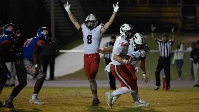 North Oconee's Bubba Chandler scores a touchdown as receiver Gavin Bloom (8) celebrates. North Oconee won the game 31-7.