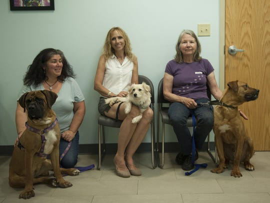 """Volunteers Kristin Ramer, with """"Regina""""  Jill Baxter"""