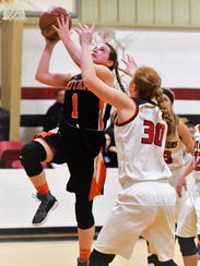 Rotan's Kaitlin Bowen goes up for a shot with Kaylee