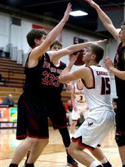 Spring Grove players block Pacelli player A.J. Firminhac