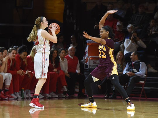 Hannah Hand takes a contested shot against Iona on