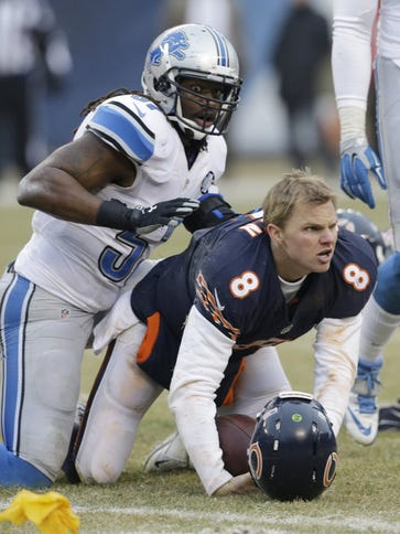 Jimmy Clausen reacts to a hit to the head from Detroit