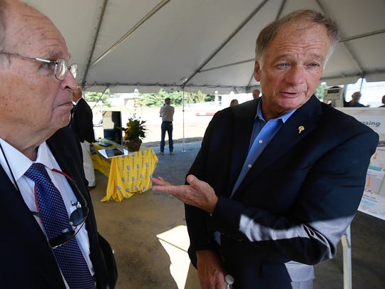 Dick Willey, president of Perdue AgriBusiness, left,