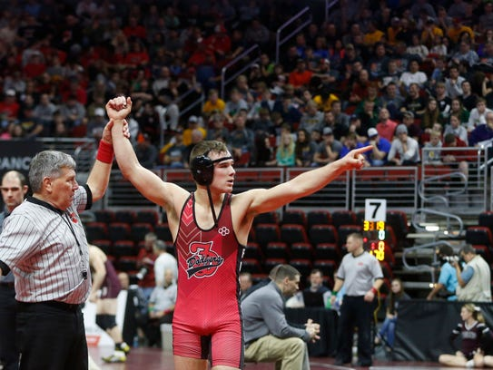 Fort Dodge's Cayd Lara points to the crowd as he celebrates