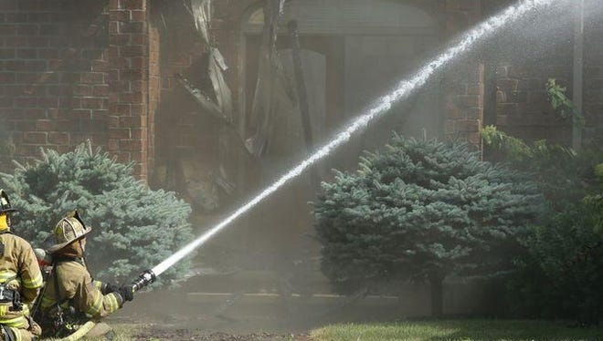 Firemen from Grand Chute and Appleton battle a blaze at 5501 W. Natures Lane in Grand Chute on Saturday, Aug. 1.