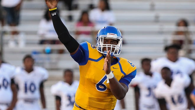 Tupelo's Stephon McGlaun (6) throws the ball during a regular season game against the Meridian Wildcats at Tupelo High on August 18, 2017.