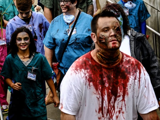 """""""Zombies"""" make their way to the Lansing Center in the"""