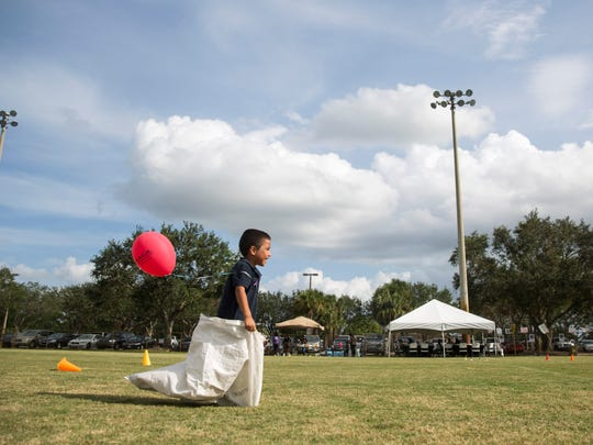 Christopher Meija, 5, competed in a sack race during the Peace Fair at the Sports Complex in Immokalee on Monday, Oct. 23, 2017. The event, hosted by The Shelter Naples, offered families food, music and games while also raising awareness of domestic violence.