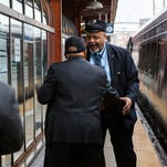 Amtrak conductor Bill Link (right) shakes hands with Rep. John Lewis as Lewis arrives in Wilmington to meet Sen. Chris Coons on Friday morning.