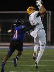 Moorpark's Drake London pulls down a pass during a game last season. London plans to play football and basketball at USC after his final year at Moorpark.