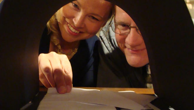 """Nicole Champeny and Dan Sallinen check the mailbox in a scene from the Rogue Theater production of the comedy """"Hate Mail,"""" running Sept. 2 to 4 at Baileys Harbor Town Hall."""