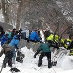 Rescuers dig frantically at the scene of an avalanche in Missoula's Rattlesnake Valley on Feb. 28.