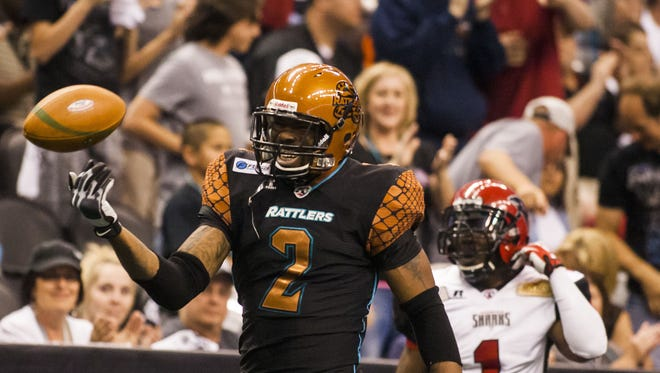 Rattlers Maurice Purify (2) reacts after a good play during the Jacksonville Sharks and Arizona Rattlers arena football game on Saturday, April 5, 2014 in Phoenix, Arizona.