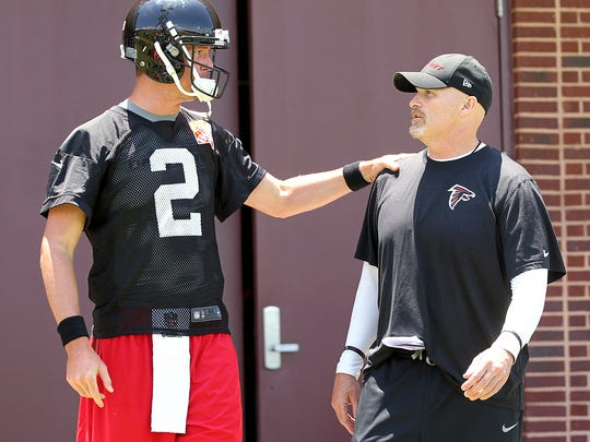 File- This June 17, 2015, file photo shows Atlanta Falcons quarterback Matt Ryan, left, and head coach Dan Quinn chatting as they walk to the field at NFL football minicamp, in Flowery Branch, Ga. Ryan hoped to take greater advantage of his one offensive series in the Falcons' preseason opener at the Jets last week, but instead the offense fell flat in a 17-0 loss. Ryan and the Falcons get another chance to get the offense on track in Friday night's game against the Chiefs.  (Curtis Compton/Atlanta Journal-Constitution via AP)