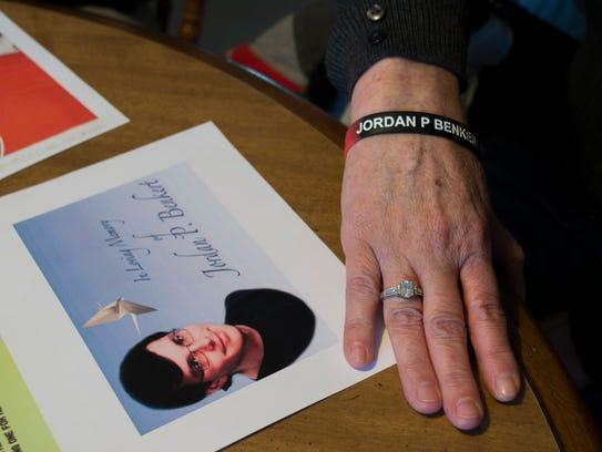 Lisa Benkert wears a bracelet for her son, Jordan,