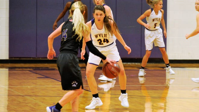 Wylie's Mary Lovelace plays defense against Midland High on Tuesday night. The Lady Bulldogs won 46-37.
