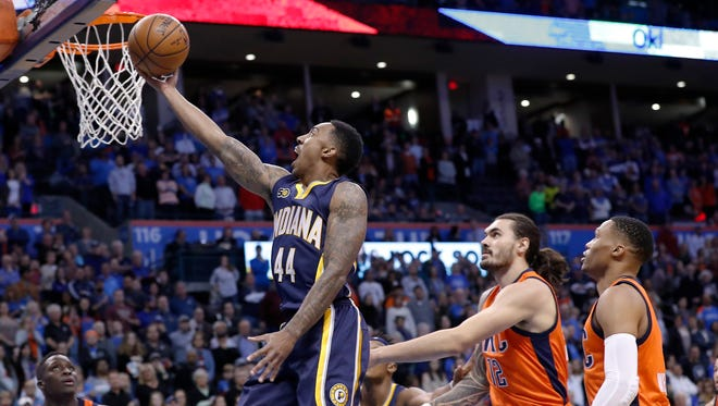 Indiana Pacers guard Jeff Teague (44) goes to the basket as Oklahoma City Thunder center Steven Adams (12) and guard Russell Westbrook (0) look on during the first half of an NBA  game in Oklahoma City on  Sunday, Nov. 20, 2016.