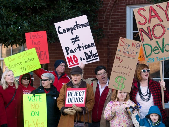 More than 300 people gathered outside of Sen. Lamar Alexander's office on Monday, January 30, 2017 to protest the nomination of Betsy DeVos as Secretary of Education.