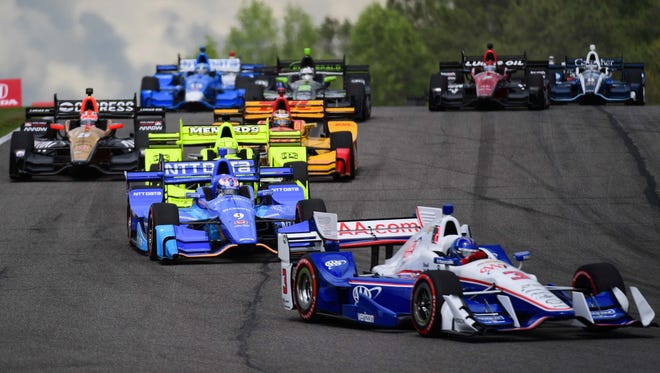 Verizon IndyCar Series driver Scott Dixon (9) in a pack of drivers at the start of the race during the Honda Indy Grand Prix of Alabama at Barber Motorsports Park.