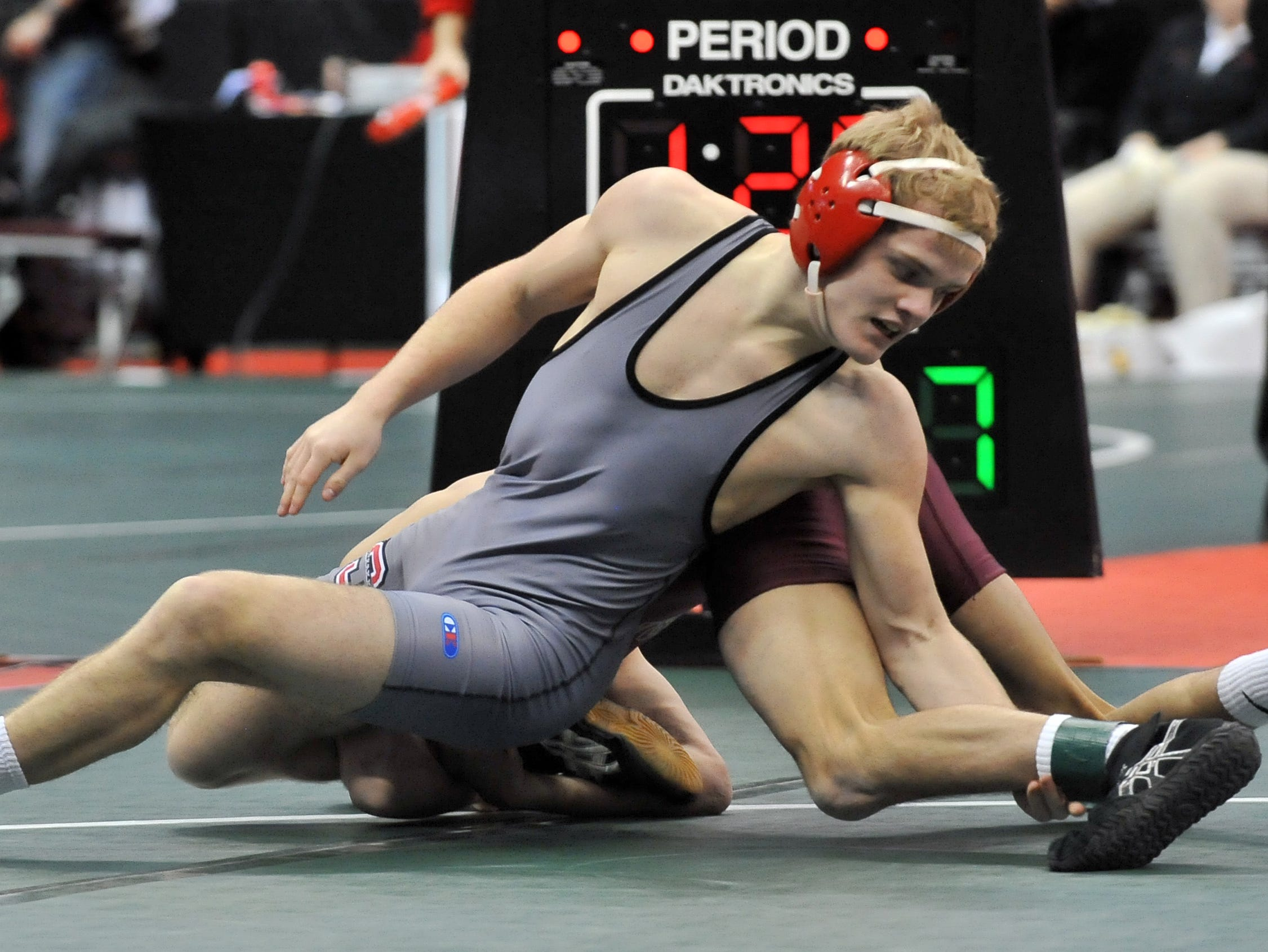 Sheridan's Nathan Kehn wrestles during the Division II state wrestling tournament Thursday, March 12, 2015, at the Jerome Schottenstein Center in Columbus.