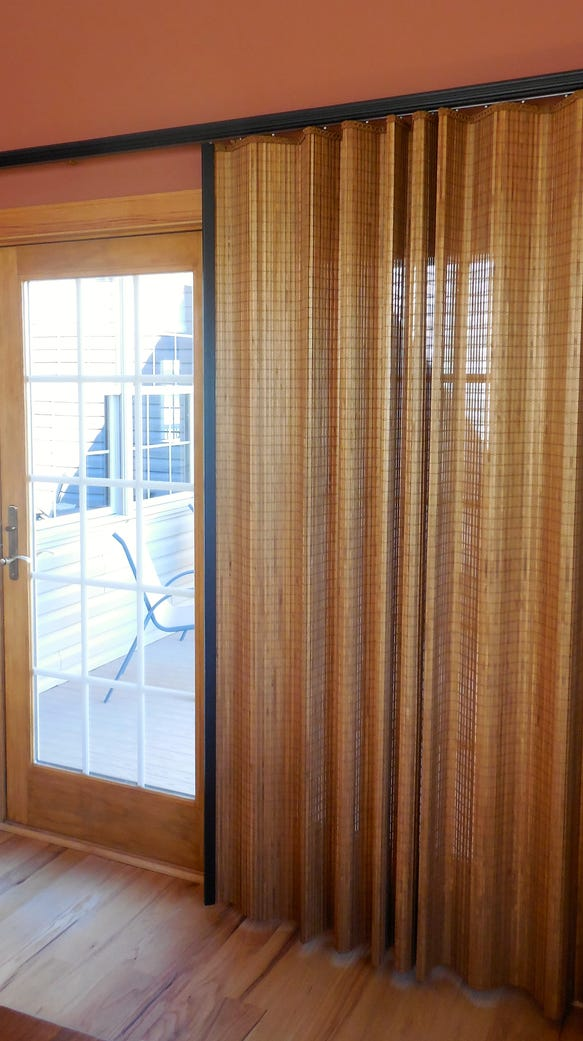 Wooden blinds add a warm tone to a room design.