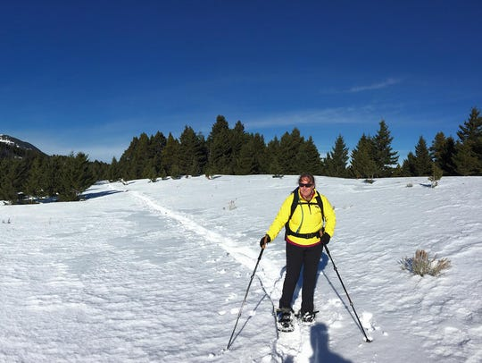 A snowshoer treks through the Highwood Mountains' Middle