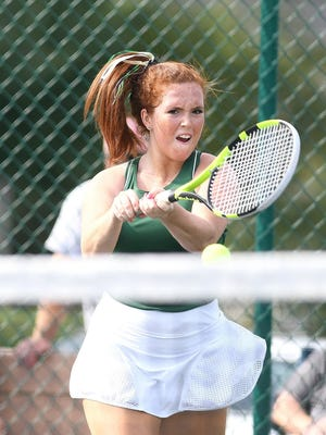 GlenOak first singles player Elaina Norris hits a backhand shot against Alliance's Alyssa White in a match played Wednesday.