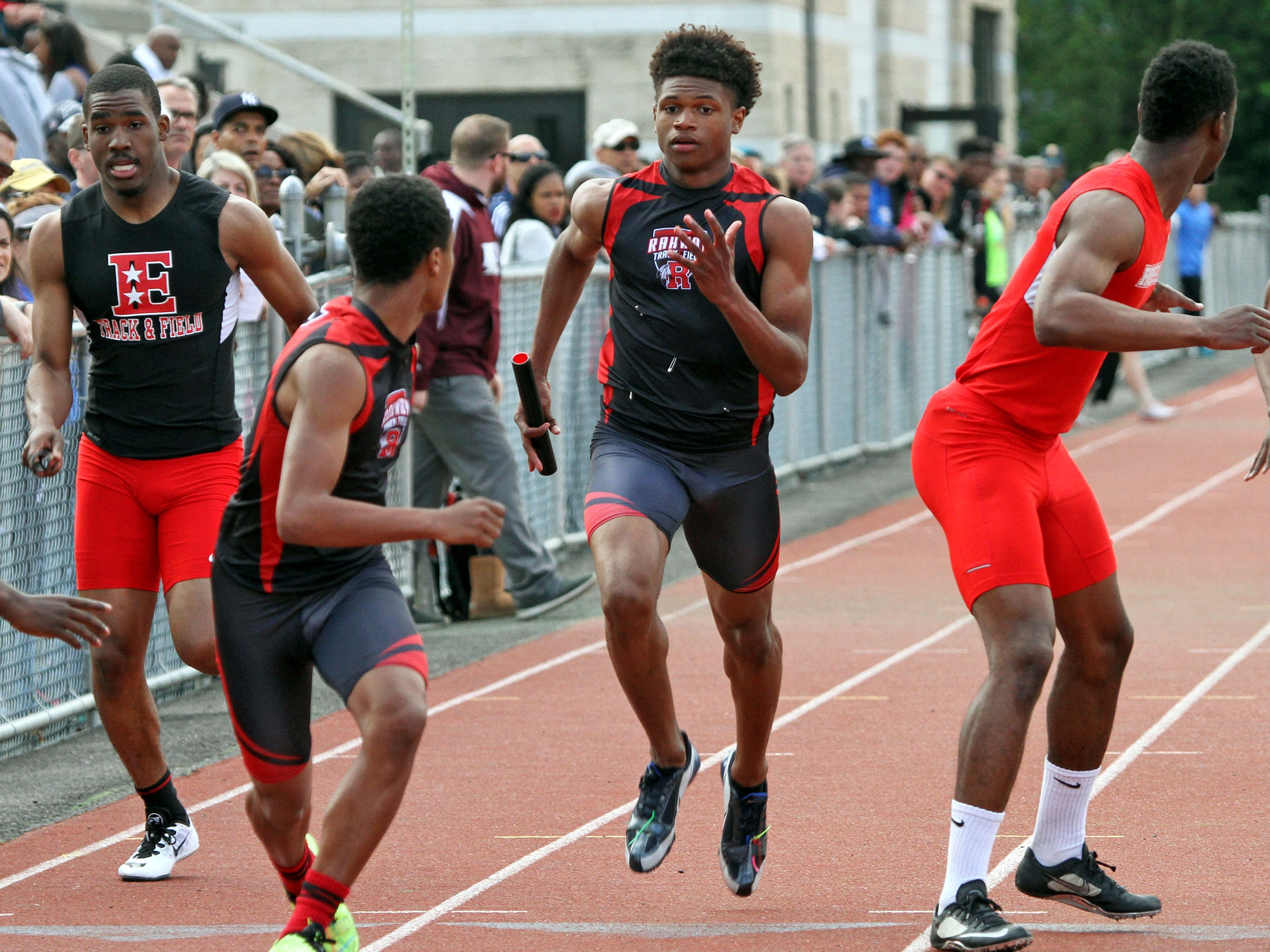 Rahway's Deshawne Bunion, center, is about to hand off the baton to Nasir Velez during the boys 4x200. This is action of the Union County Track and Field Relays.