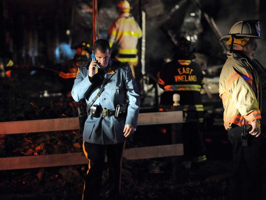 A New Jersey State Trooper is seen at the site of a