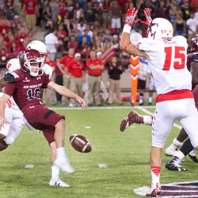 Aggies punter gets off a difficult punt after mishandling