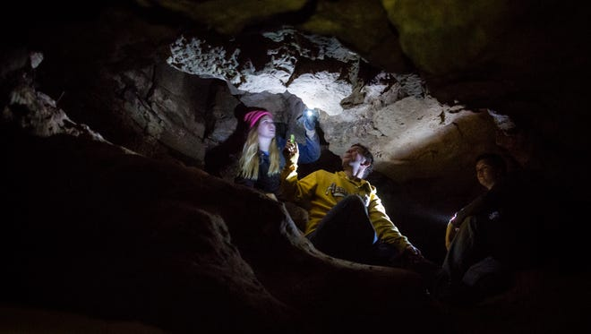 Carolyn Barth of New Holstein, left, leads Nathan, center, and Trevor Juckem through the Dark Room during a tour of Carolyn's Caverns at the Ledge View Nature Center Wednesday, August 27, 2014, in Chilton, Wis. The cave system which reaches 36 feet underground at the deepest point, was naturally formed by groundwater and glacial melt water. Tours of the cave system can be scheduled by contacting the Ledge View Nature Center.
