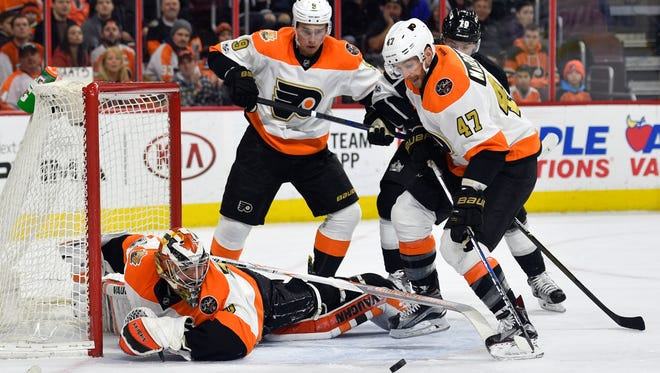 Michal Neuvirth made several athletic saves keeping the Flyers in the game until Jeff Carter scored in overtime.