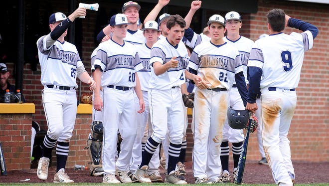 Dallastown catcher Bryant Holtzapple (9) high fives teammates after scoring a run against Hatboro-Horsham in the first round of the PIAA Class 6A baseball tournament at Red Lion Area Senior High School in Red Lion Monday, June 5, 2017.