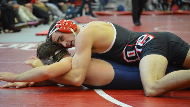 Olivet College's Ross Pennock (top) went 3-0 at the Comet Duals on Nov. 21.